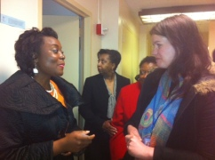Mary speaks with an attendee after the event.