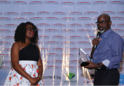 Mary Olushoga receiving award from Senator Liyel Imoke